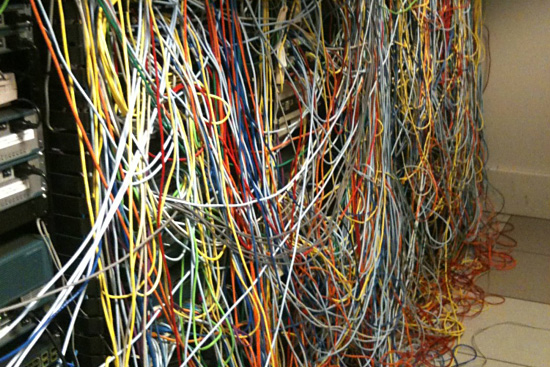 An example of a very messy server room with wires everywhere.
